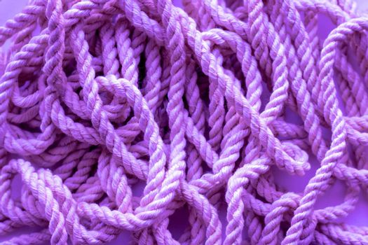 Sea rope, clothesline, close-up background texture, lilac background