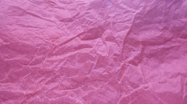 Crumpled paper with a pink texture. Texture of crumpled paper. Crumpled paper. Paper wrinkles