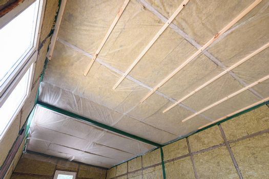 Insulation of the roof from the inside with mineral wool in a wooden country house