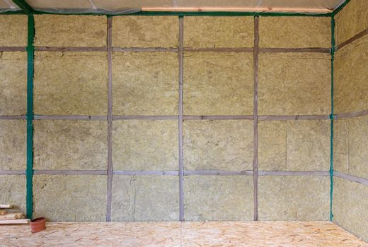 Wall of a frame house from the inside insulated with mineral wool