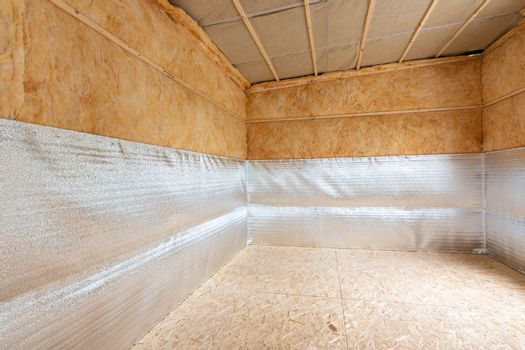 Combination of insulation during the construction of a house, a heat-insulating layer of reflective foamed polyethylene laminated with lavsan when insulating a house