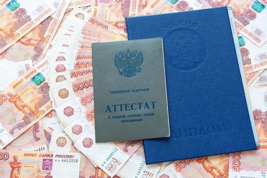 A certificate and a diploma are on the five thousandth Russian rubles