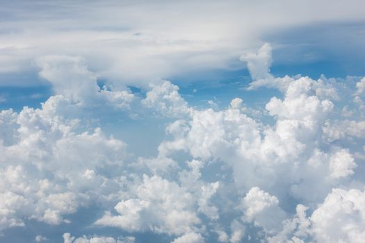 Cloud with blue sky from airplane window