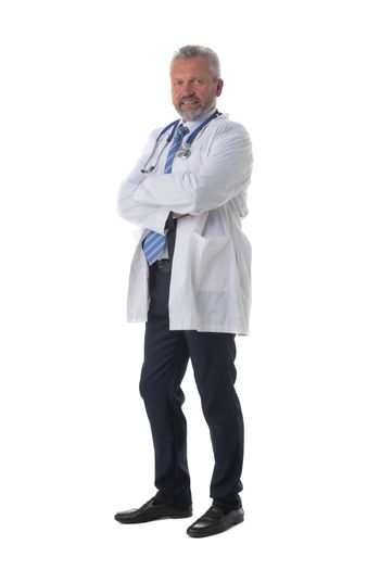 Caucasian mature male medical doctor with stethoscope isolated on white background, full length portrait