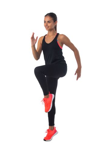 Healthy hispanic fitness girl with doing workout squat exercise isolated on white background