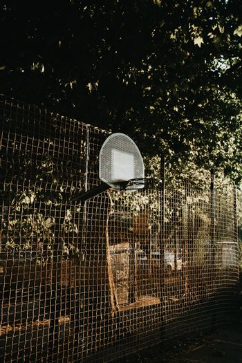 A close up of the basket in the court during a sunset
