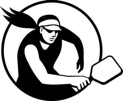 Retro style illustration of a female pickleball player, a paddleball sport that combines elements of tennis, badminton, and table tennis set inside circle isolated background done in black and white.