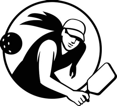 Retro style illustration of a female pickleball player, a paddleball sport that combines elements of tennis, badminton, and table tennis set in circle isolated background done in black and white.