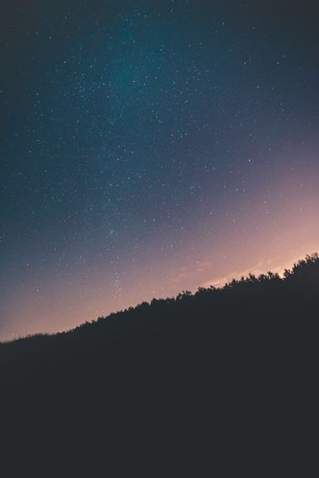 Stars over a black mountain