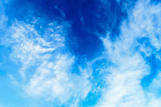 Blue sky background. Cloudy blue sky. Blue sky Abstract background with Dramatic tiny clouds floating. Fluffy Cloud Texture From A Perfect Cloudy spring time of day.