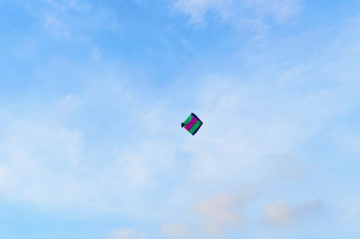 Kite flying in the sky. Kites flying picture with blue sky and white clouds. Photography in the eve of Vishwakarma Puja in Kolkata. Low angel View. Motion Blur.