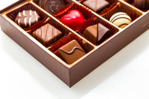Assorted chocolates in brown box, with red heart chocolate