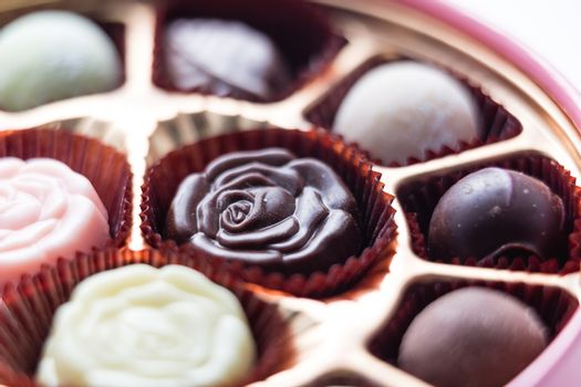 Assorted chocolates in pink box, shallow depth of field