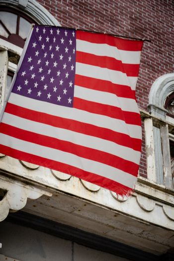 American flag in front of colonial style building