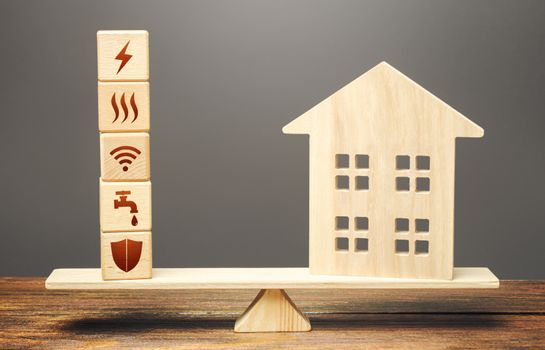 House and blocks with utilities public service symbols on scales. Availability of bill payment. Home is too big and its maintenance costs are high. Improve water and energy efficiency. Energy saving