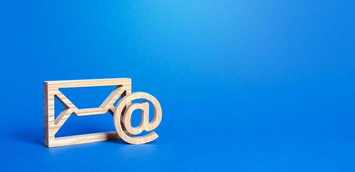 Email figure on blue background. Envelope and AT commercial sign symbol. Concept of email address. Contacts and communication. Business representations on the Internet and social media. Feedback