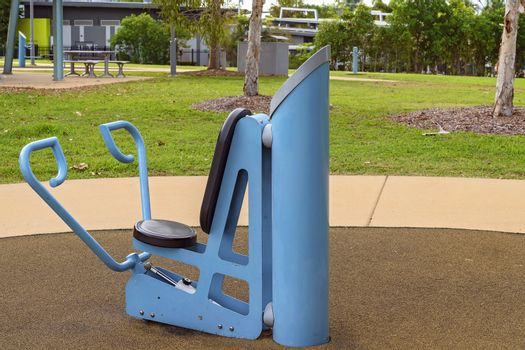 An exercise machine to warm up and stretch before running on the recreational track, available for public use