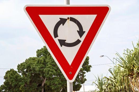 A Metal Triangular Roundabout Sign