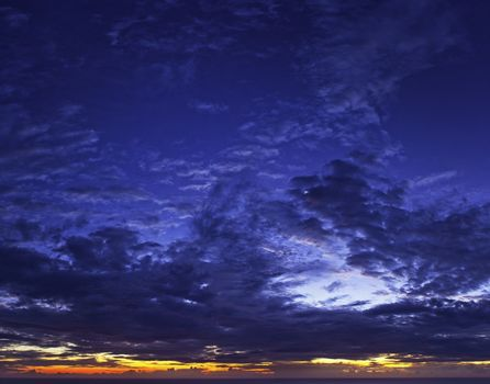 A beautiful cloudy sunset over the distant horizon