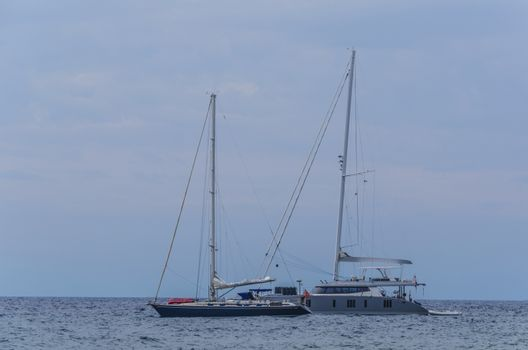 On the Tyrrhenian sea off the coast of Lipari island sail two modern sailing boats