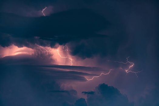 Lightning strike on the dark cloudy sky, background