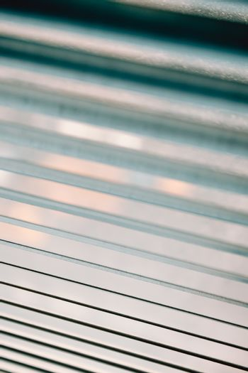 Close up wallpaper of a blind with cinematic tones during a sunny day