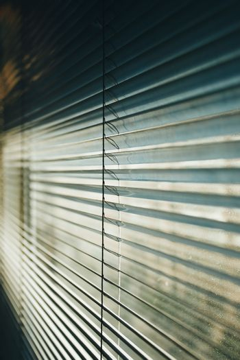 Wallpaper of a blind with cinematic tones during a sunny day