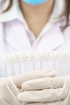 Technician scientist analyzing holding test tube in laboratory for testing it on COVID, COVID-19, coronavirus virus analysis
