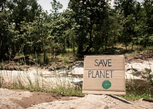 The nature conservation sign on stream flowing background. The concept of World Environment Day. Zero waste.