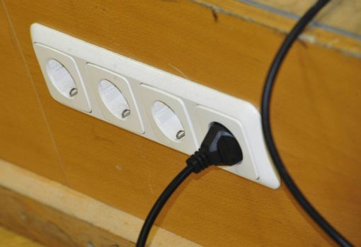 a white 220 volt socket in the wall at home