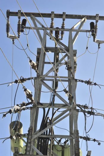 an electricity Transformer with clear blue sky in the background