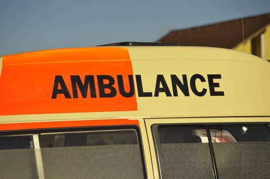 an Ambulance sign on the roof of a rescue transport vehicle