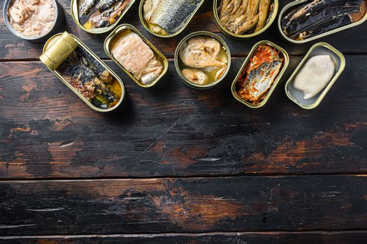 opened cans conserve with Saury, mackerel, sprats, sardines, pilchard, squid, tuna over wood table top view space for text