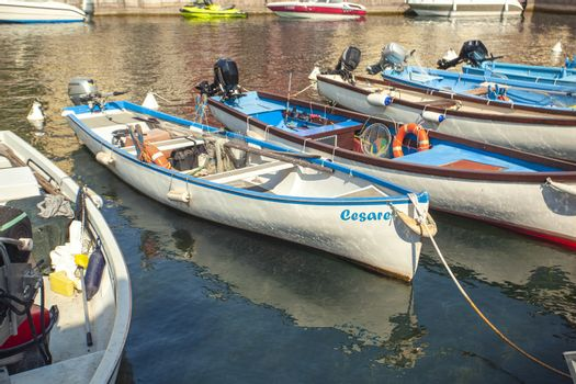 LAZISE, ITALY 16 SEPTEMBER 2020: Dogana Veneta and Porticciolo in Lazise, in Italy with colored boats