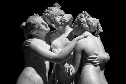 Milan, Italy - June 2020: Antonio Canova's statue The Three Graces (Le tre Grazie). Neoclassical sculpture, in marble, of the mythological three charites (made in Rome, 1814-1817)