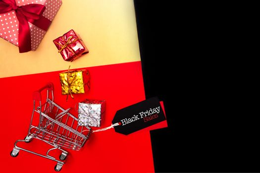 Black Friday sale, shopping cart and gift box with price tag