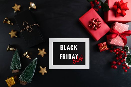 gift box with photo frame for Black Friday Sale concept on black background