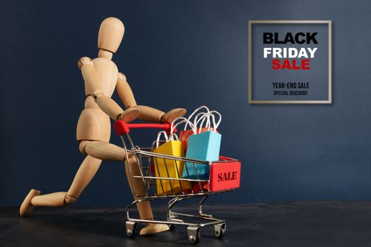 Black Friday sale, wooden door running with shopping cart
