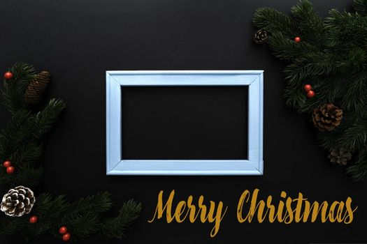 Christmas pine tree and photo frame with xmas decoration on black background
