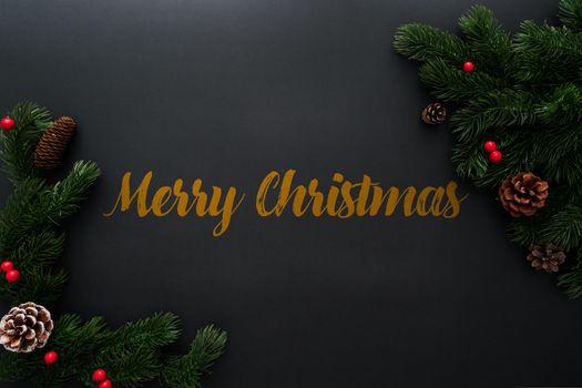 Christmas pine tree with xmas decoration on black background