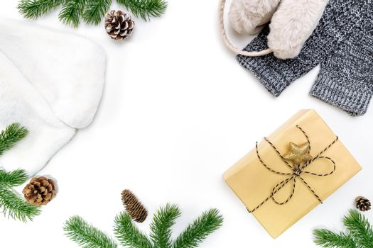 Christmas winter composition. Christmas gifts box with pine cones, fir branches on white background. Flat lay, top view, copy space