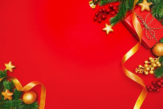 Christmas present and pine tree with xmas decoration on Red background