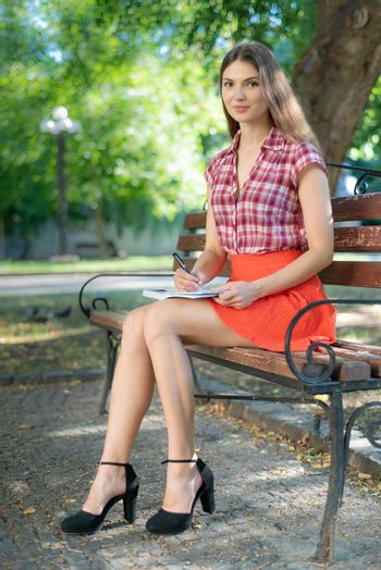 Young girl student on a bench. Kyiv. Ukraine