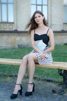 Girl student on a bench. Kyiv. Ukraine