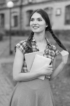 Girl student in skirt and plaid shirt. Kyiv. Ukraine