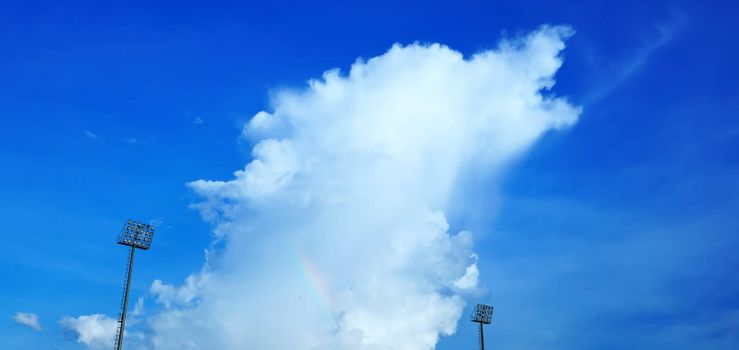 The stadium's sky has pillars, spotlights, and a rainbow.