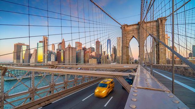 Brooklyn Bridge in New York City, USA at sunrise