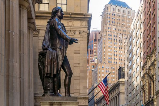 Wall Street  in Manhattan Finance district and Washington statue in the foreground