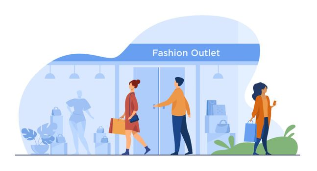 Consumers walking along street near apparel store