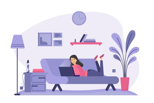 Woman lying on couch and using laptop